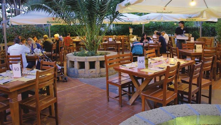 Al fresco dining at Park Albatros Campsite in San Vincenzo, Italy