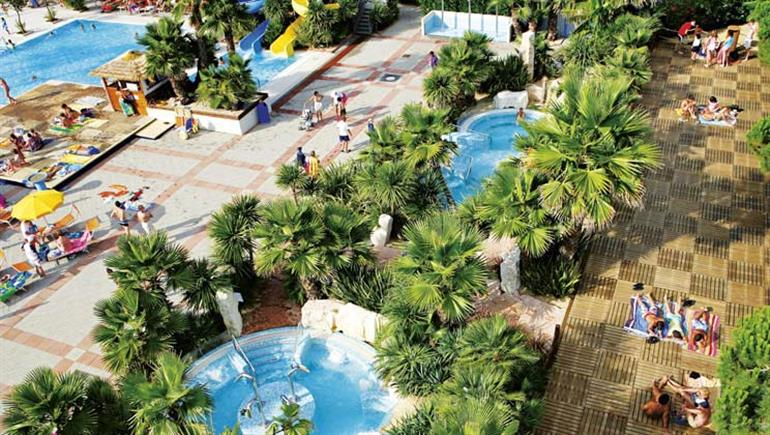 Swimming pools and hot tubs at Portofelice Camping Village in Eraclea Mare, Italy